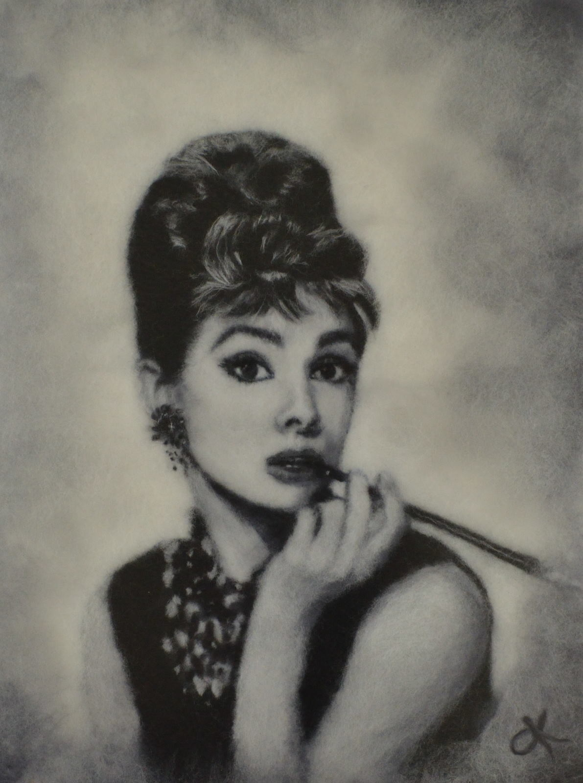 Portrait of Audrey Hepburn with a cigarette holder made of merino wool. Wool Art Gallery